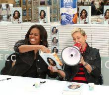 Watch Ellen DeGeneres pester Michelle Obama during her book signing