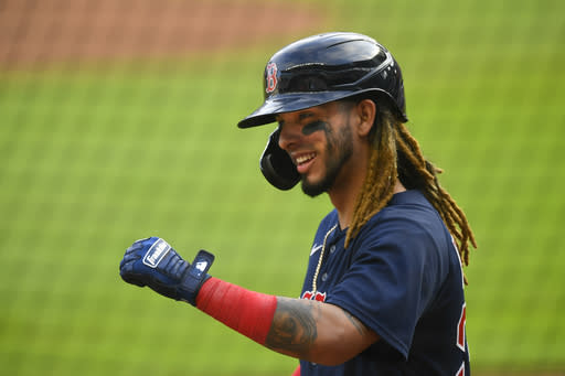 Boston Red Sox's Jonathan Arauz celebrates a solo home run against the Atlanta Braves as he enters the dugout during the ninth inning of a baseball game Sunday, Sept. 27, 2020, in Atlanta. (AP Photo/John Amis)