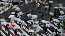 Tokyo governor tells residents to stay home over holiday as virus surges