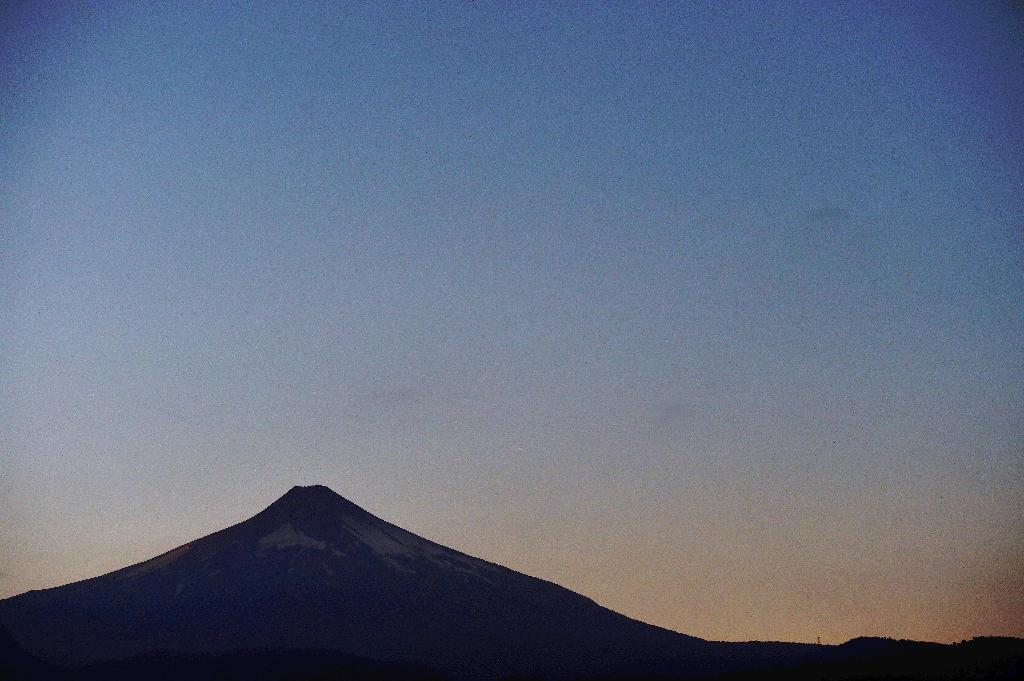 A view of the Villarrica volcano, seen from Pucon, Chile, showing no visible signs of activity on March 5, 2015