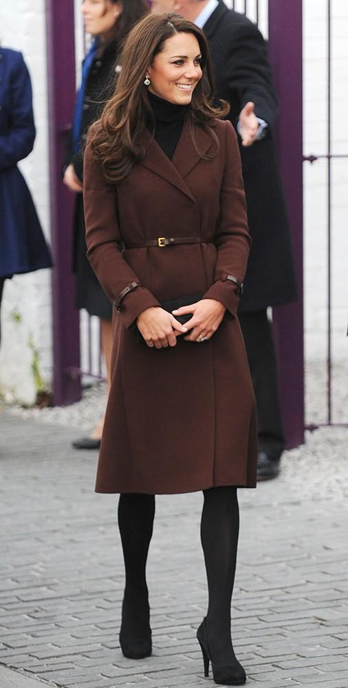 Kate wore this brown Hobbs coat to visit Liverpool, pairing it with black stockings and pumps.