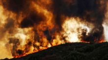 Crews battling deadly California wildfire slowed by returning winds