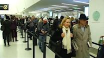 Thanksgiving travelers pack roads, airports