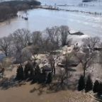 Two people dead as devastating flooding overwhelms the Midwest
