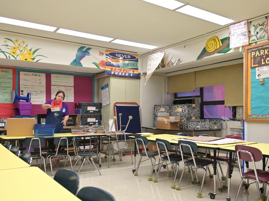 Melissa Wong, a teacher at Yung Wing School P.S. 124, swaps materials between her classroom and the stock room to prepare for the 2020/2121 school year on August 17, 2020 in New York City.