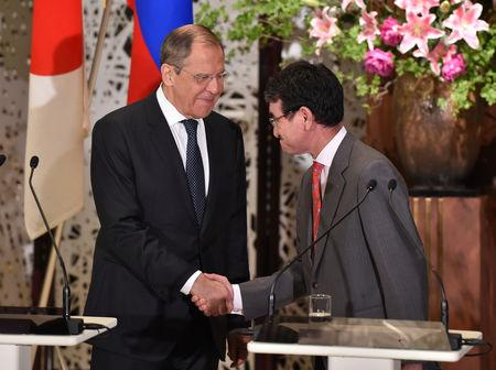 Russian Foreign Minister Sergei Lavrov shakes hands with Japanese Foreign Minister Taro Kono during their joint news conference after their two-plus-two Foreign and Defense Ministers meeting between Japan and Russia at the Iikura Guest House in Tokyo, Japan, May 30, 2019. Kazuhiro Nogi/Pool via Reuters