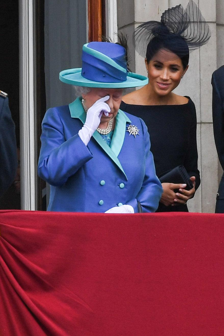 LONDON,  UNITED KINGDOM - JULY 1O:  Queen Elizabeth ll and Meghan, Duchess of Sussex stand on the balcony of Buckingham Palace to view a flypast to mark the centenary of the Royal Air Force (RAF)  on July 10, 2018 in London, England. (Photo by Anwar Hussein/WireImage)