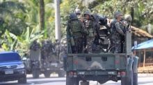Philippines deploys helicopters in battle to retake city from Islamist rebels