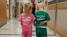 Photo of girl wearing 'Nurse in Training' and boy in 'Doctor in Training' scrubs slammed as sexist