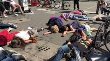 Extinction Rebellion Protesters Stage 'Die-In' in Cologne