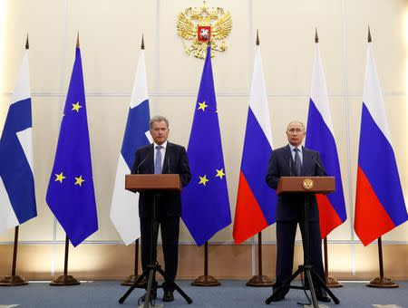 Finnish President Sauli Niinisto and Russian President Vladimir Putin attend a joint news conference following their meeting at the Bocharov Ruchei state residence in the Black Sea resort of Sochi, Russia August 22, 2018. Pavel Golovkin/Pool via REUTERS