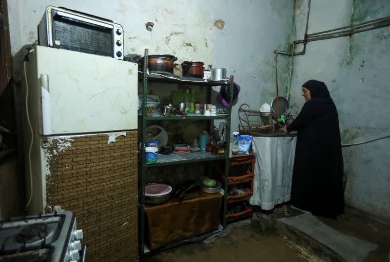 Mariam Khaled Maksoud works inside her kitchen in Tripoli