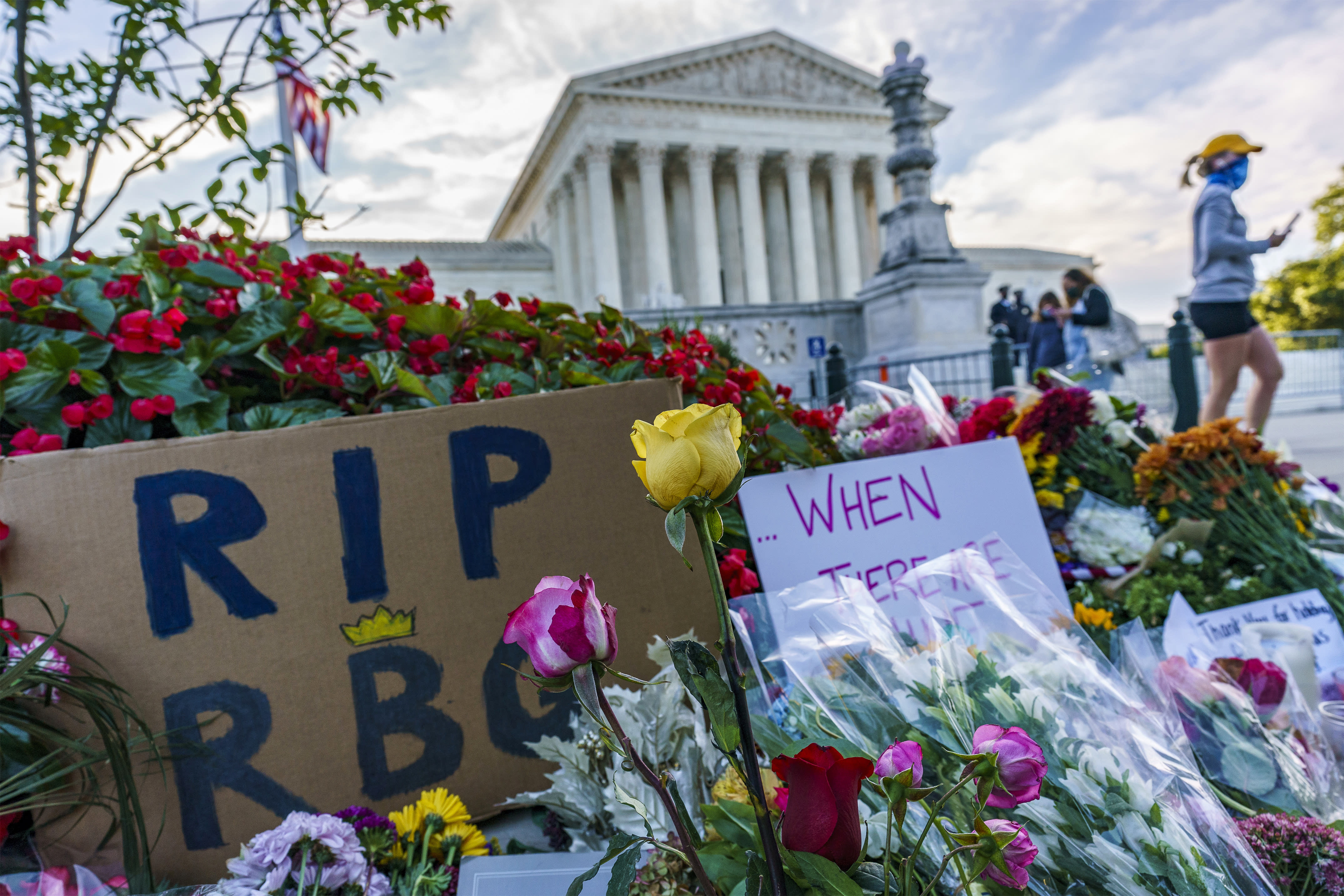 People gather at the Supreme Court on the morning after the death of Justice Ruth Bader Ginsburg, 87, Saturday, Sept. 19, 2020 in Washington. (AP Photo/J. Scott Applewhite)