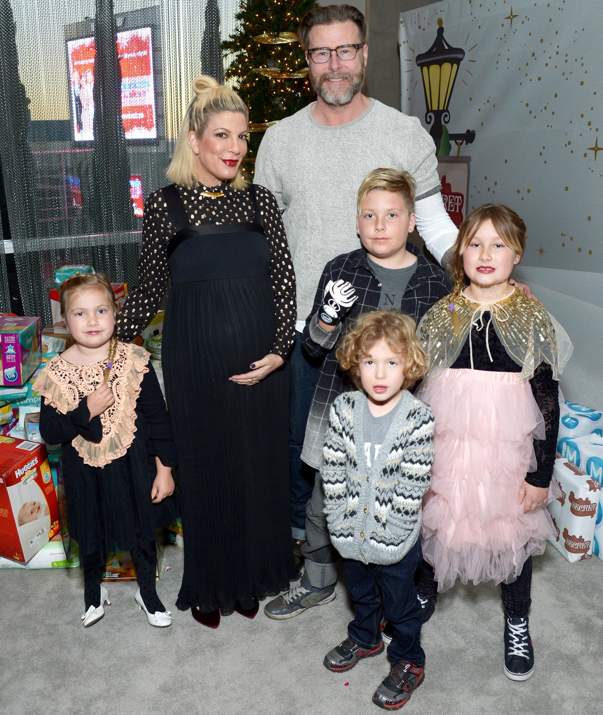 pregnant tori spelling steps out with her family for early christmas celebrations