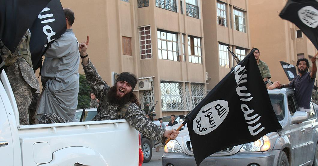 An image made available by Jihadist media outlet Welayat Raqa on June 30, 2014 allegedly shows a member of the Islamic state militant group parading in a street in the Syrian city of Raqa (AFP Photo/)