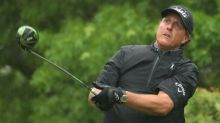 Mickelson, Johnson reach last 16 at WGC Match Play