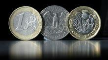 El euro sube ante el dólar y el mercado escruta Cataluña y la Fed