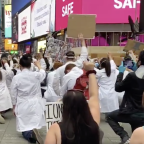 Watch Healthcare Workers Kneel In Solidarity With Protestors in Times Square
