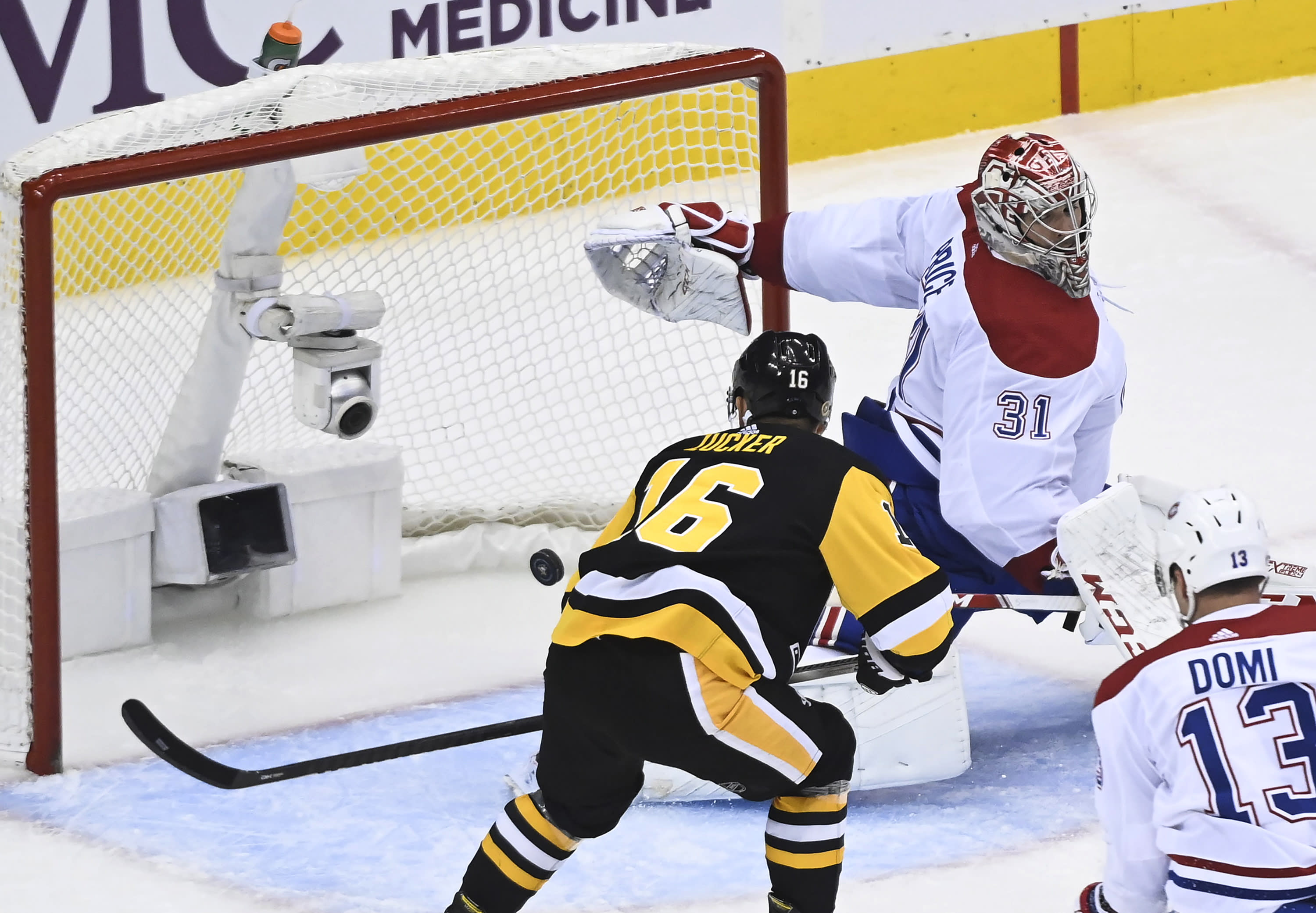 Pittsburgh Penguins left wing Jason Zucker (16) scores past Montreal Canadiens goaltender Carey Price (31) during the third period of an NHL hockey playoff game Monday, Aug. 3, 2020, in Toronto. (Nathan Denette/The Canadian Press via AP)