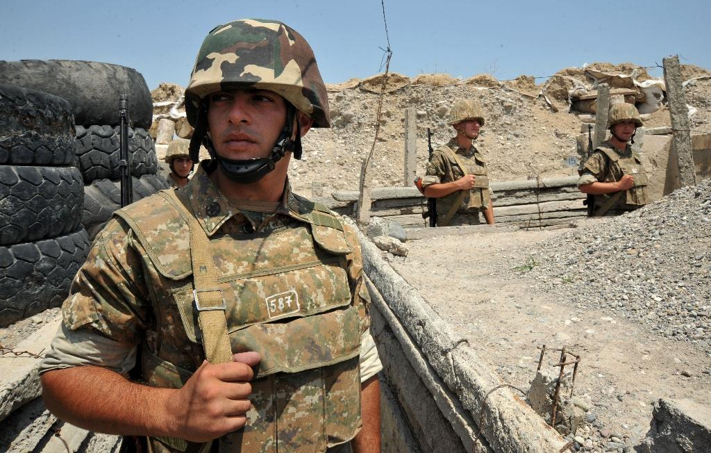 Armenian soldiers stand in trenches at the frontline on the border with Azerbaijan near the town of Martakert, on July 6, 2012 (AFP Photo/Karen Minasyan)