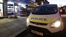 Teenager arrested on suspicion of murdering shopkeeper who was killed for 'refusing to sell cigarette papers'