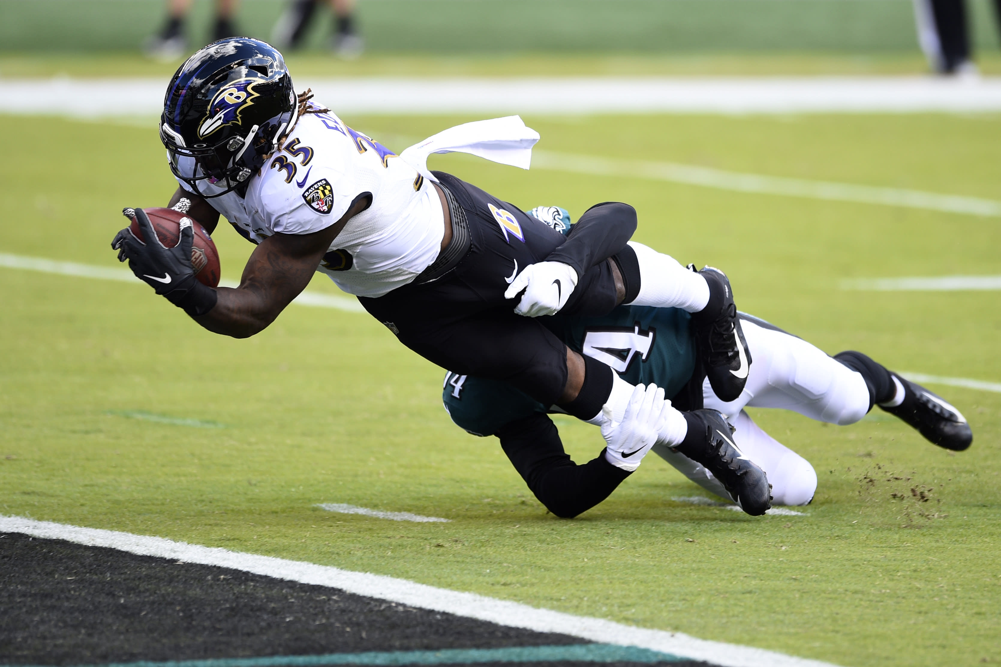 Baltimore Ravens' Gus Edwards (35) scores a touchdown as Philadelphia Eagles' Shaun Bradley (54) during the first half of an NFL football game, Sunday, Oct. 18, 2020, in Philadelphia. (AP Photo/Derik Hamilton)