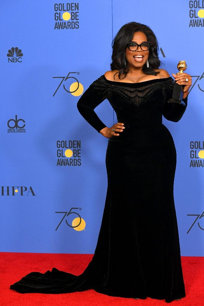 Oprah Winfrey poses with her lifetime achievement award received at the 75th Annual Golden Globe Awards (AFP Photo/KEVIN WINTER)