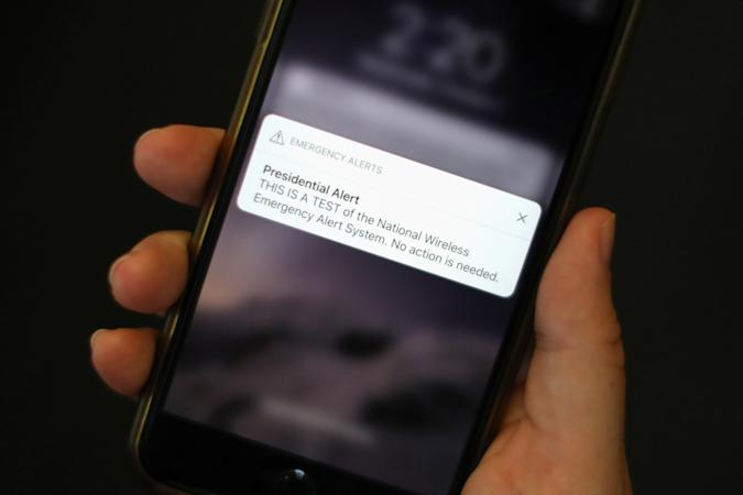 A test text message of the Presidential Alert, National Wireless Emergency Alert System is seen on a mobile phone in New York City, New York, U.S. October 3, 2018. REUTERS/Mike Segar
