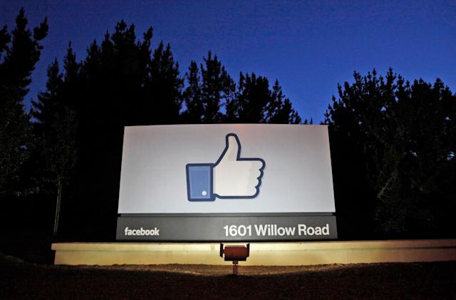 Facebook takes down militia group that organized armed response to protests