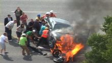 Video: Miracle rescue from motorcycle fireball