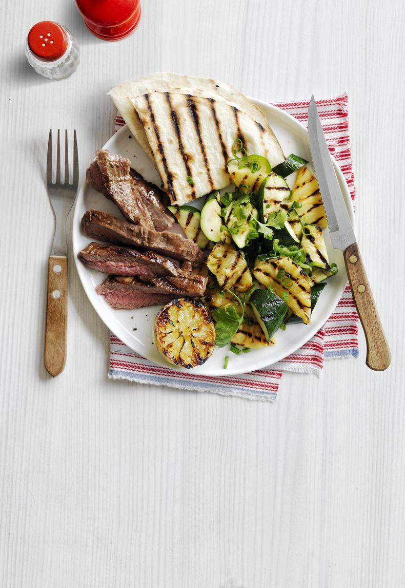 """<p>This juicy steak recipe only takes half an hour to make! Make sure to serve with gluten-free tortillas. </p><p><em><a href=""""https://www.womansday.com/food-recipes/recipes/a50550/grilled-skirt-steak-charred-zucchini-pineapple-salad-recipe-wdy0615/"""" rel=""""nofollow noopener"""" target=""""_blank"""" data-ylk=""""slk:Get the Grilled Skirt Steak with Charred Zucchini and Pineapple Salad recipe."""" class=""""link rapid-noclick-resp"""">Get the Grilled Skirt Steak with Charred Zucchini and Pineapple Salad recipe. </a></em></p>"""