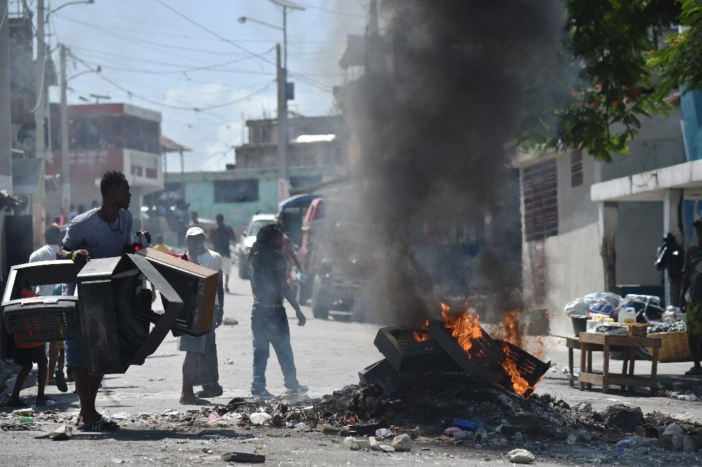 Anger over proposed fuel price hikes exploded into deadly violence and looting in Haiti's capital Port-au-Prince in July 2018 (AFP Photo/HECTOR RETAMAL)