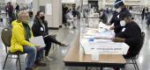 Election workers, right, verify ballots as recount observers, left, watch during a Milwaukee hand recount of presidential votes at the Wisconsin Center, Friday, Nov. 20, 2020. (AP)