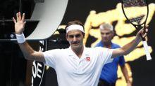 Federer fends off British 'mirror' Evans to advance