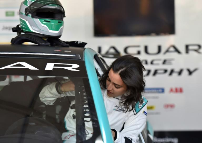 Saudi Arabia's first female racing driver Reema al-Juffali steps into her electric car ahead of the Jaguar I-PACE eTROPHY (AFP Photo/FAYEZ NURELDINE)