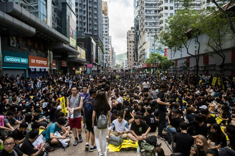 Hong Kong's pro-democracy protesters and authorities appear set for a long war of attrition (AFP Photo/Isaac Lawrence)