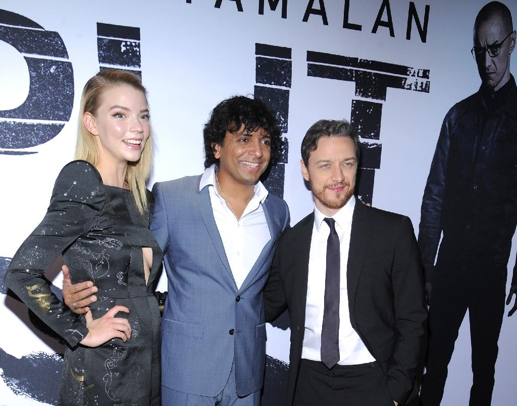 """L-R: Actress Anya Taylor-Joy, Director, writer, producer M. Night Shyamalan and actor James McAvoy attend the New Year premiere of """"Split"""" on January 18, 2017 in New York City"""