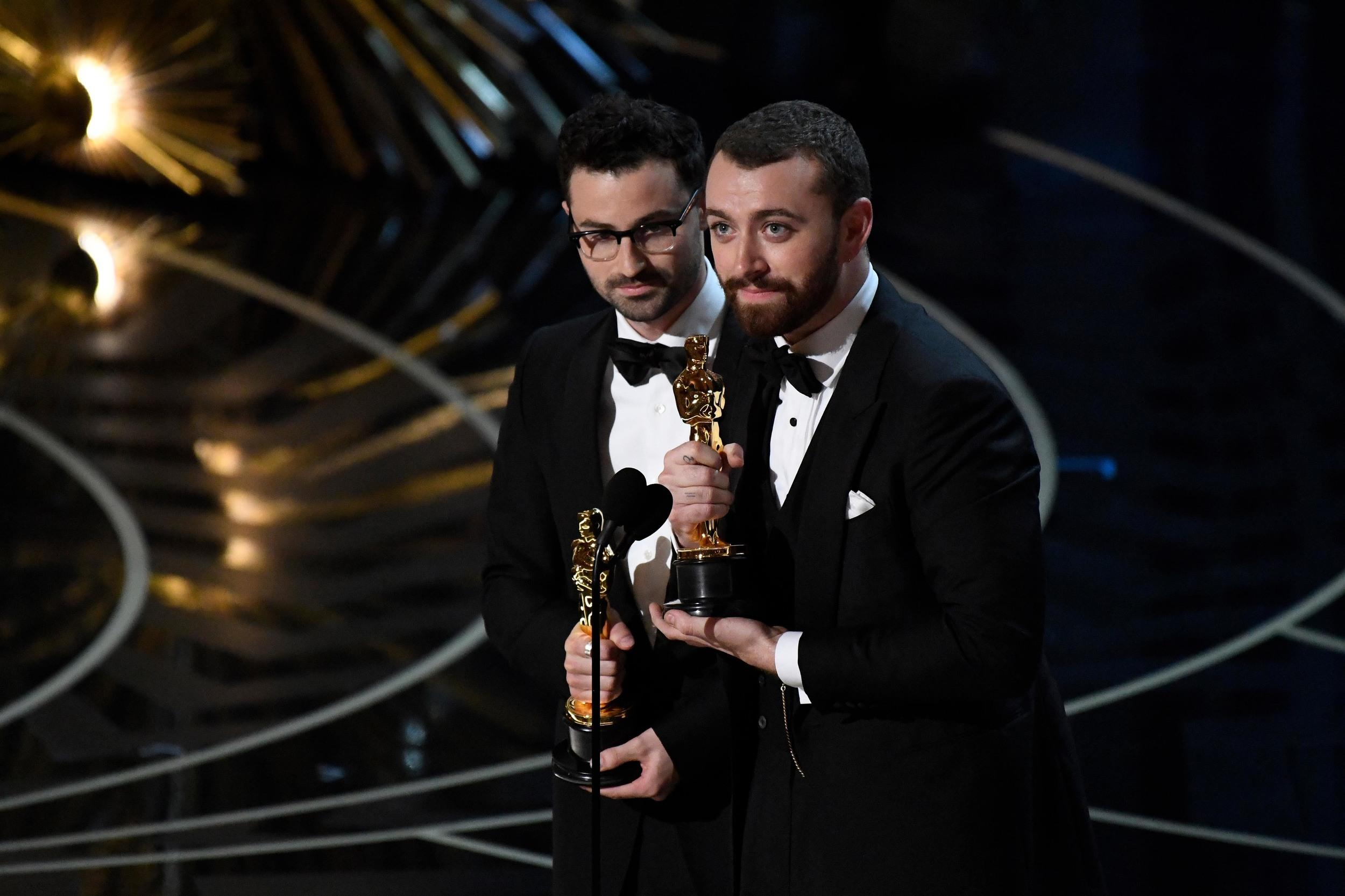 Feb 28, 2016; Hollywood, CA, USA;  Sam Smith (right) and Jimmy Napes accept the Oscar for Best Original Song for �Writing�s On The Wall� from �Spectre�  during the 88th annual Academy Awards at the Dolby Theatre. Mandatory Credit: Robert Deutsch-USA TODAY NETWORK