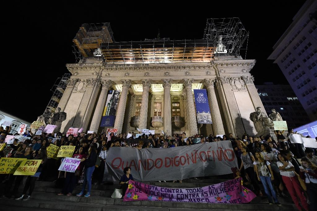 Brazilians protest in front of the Legislative Assembly of Rio de Janeiro (ALERJ) on May 27, 2016, against a gang-rape of a 16-year-old girl