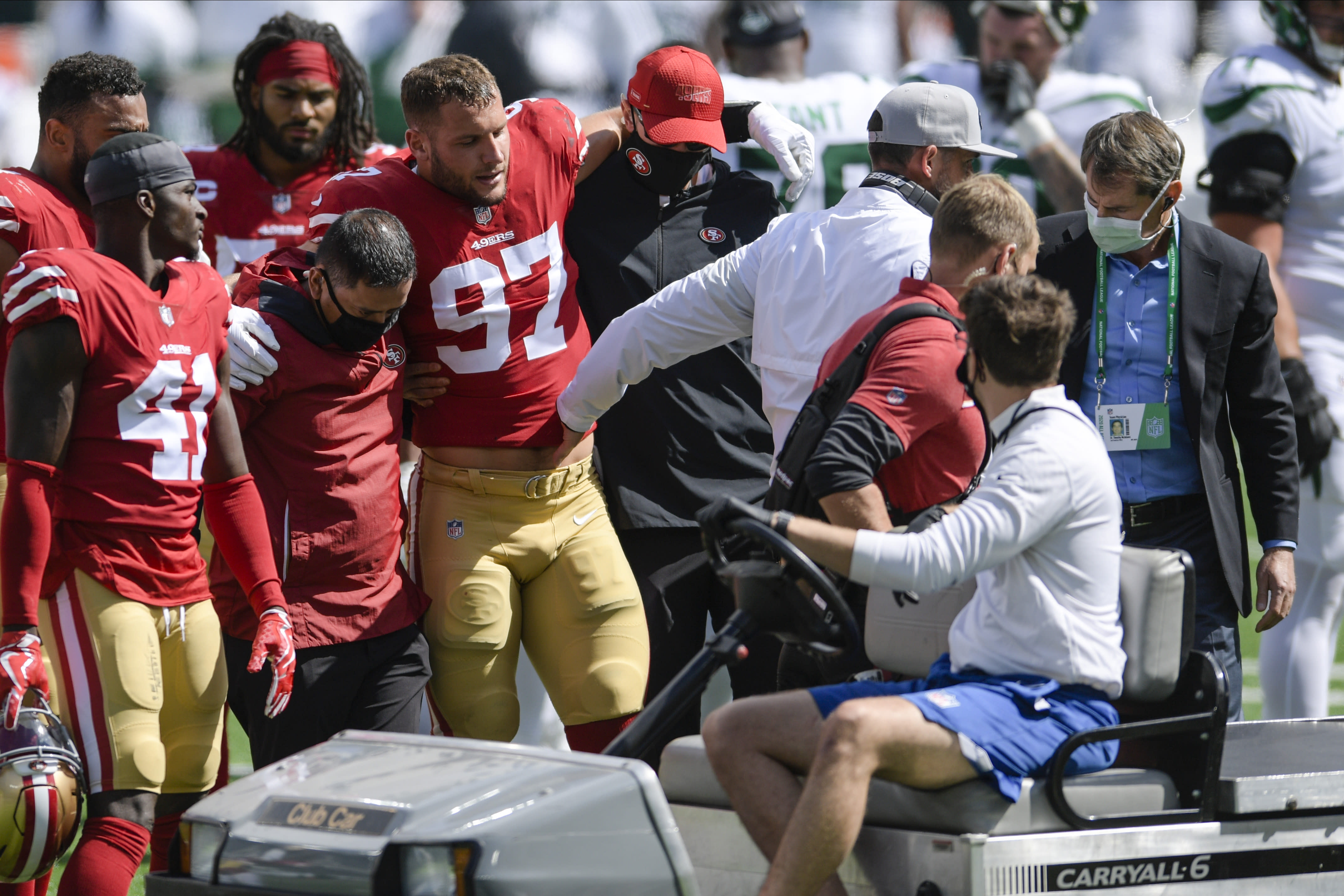 San Francisco 49ers defensive end Nick Bosa (97) is helped off the field after being injured during the first half of an NFL football game against the New York Jets, Sunday, Sept. 20, 2020, in East Rutherford, N.J. (AP Photo/Bill Kostroun)
