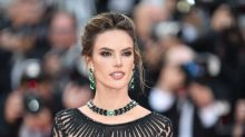 Model Alessandra Ambrosio shows major skin in tattoo gown