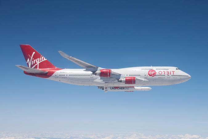 Virgin Orbit Cosmic Girl aircraft carrying Launcher One rocket