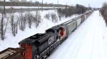 Canadian National Railway to cut management and union jobs