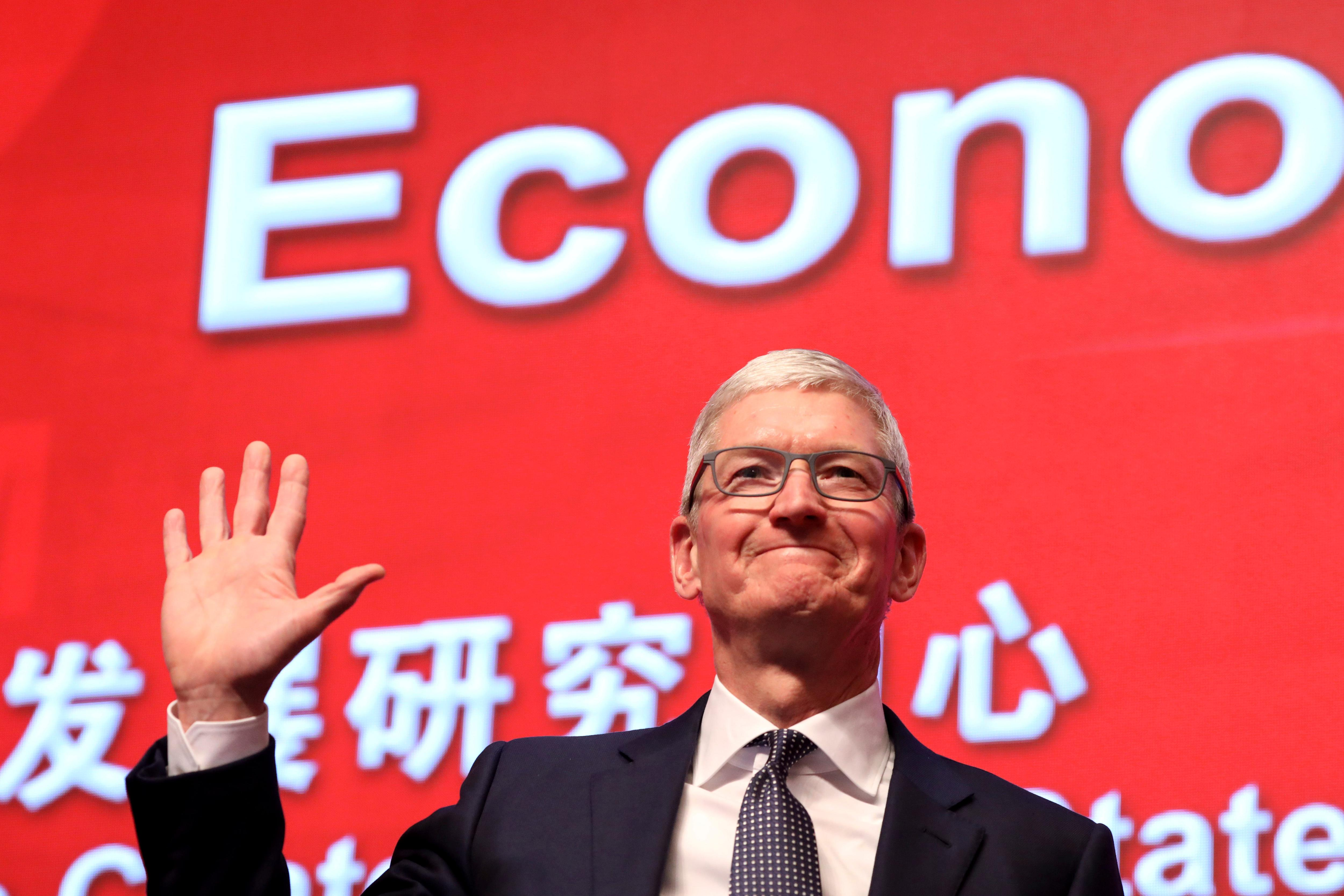 """Apple CEO Tim Cook waves as he arrives for the Economic Summit held for the China Development Forum in Beijing, China, Saturday, March 23, 2019. Cook says he's """"extremely bullish"""" about the global economy based on the amount of innovation being carried out, and he's urging China to continue to """"open up."""" (AP Photo/Ng Han Guan)"""