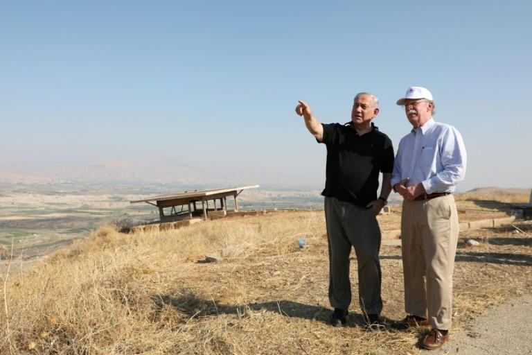 Israeli Prime Minister Benjamin Netanyahu and then US national security adviser John Bolton visit an old army outpost overlooking the Jordan Valley in June (AFP Photo/ABIR SULTAN)