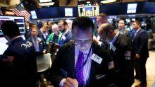 Wall Street sigue mixto a media sesión, con el Dow Jones casi plano