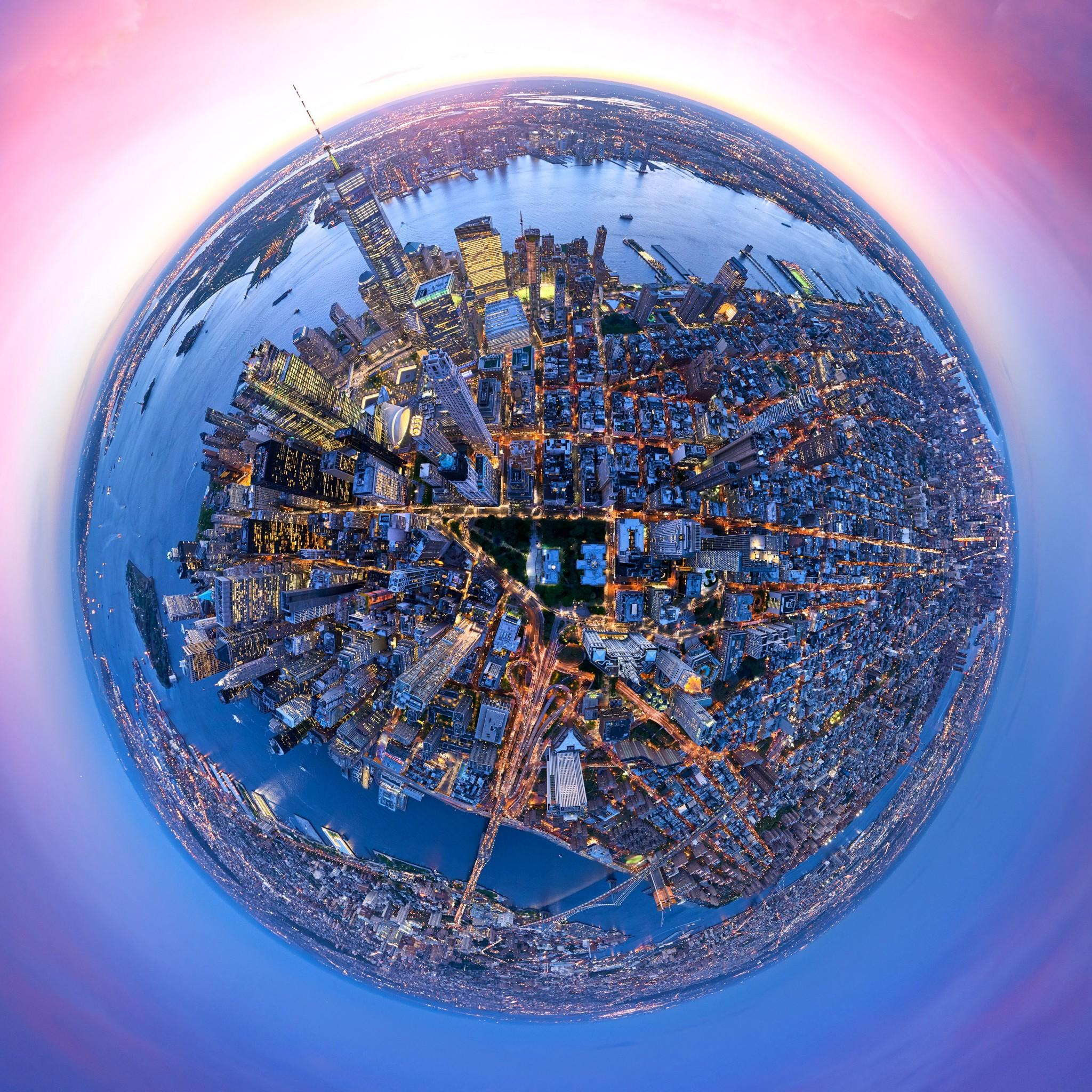 <p>In all of the works, the bright lights of New York glitter across the skyline, making its skyscrapers and life below pop. Andrew Griffiths, who has been working as an aerial photographer for the past 16 years, captured the unique photography series. (Photo: Andrew Griffiths/Lensaloft/Caters) </p>