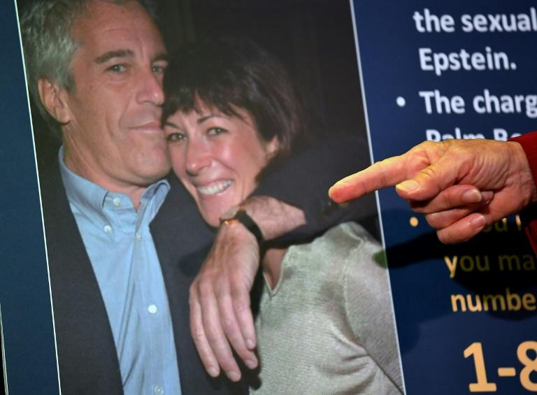 Ghislaine Maxwell -- shown here with the late disgraced financier Jeffrey Epstein -- is being held at Brooklyn's high-security Metropolitan Detention Center (AFP Photo/Johannes EISELE)