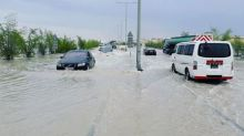 Cars Plow Through Flooded Streets in Greater Doha