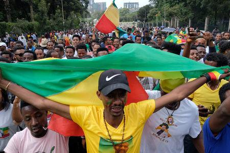 Ethiopians carry their national flag during a rally in support of the new Prime Minister Abiy Ahmed in Addis Ababa